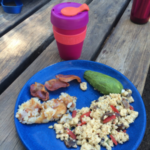Veggie scramble, shredded potatoes, avocado, bit of bacon... and coffee!